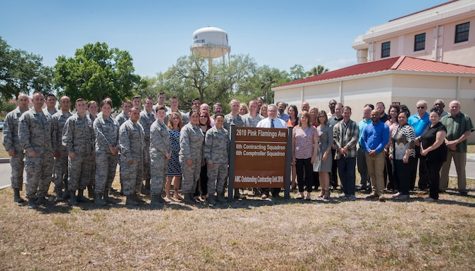 U.S. Air Force Airmen assigned to the 6th Contracting Squadron (CONS) pause for a photo at MacDill Air Force Base, Fla., April 3, 2018.