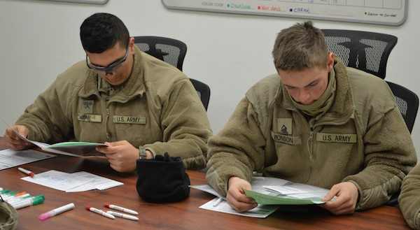 Army Pvts. Joshua Monson and Rami Safi review the blood donor information before donating. Both soldiers are completing training at the Joint Base San Antonio-Camp Bullis Soldier Medic Training Site and volunteered to donate blood.
