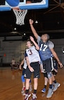 Christopher Williams, a forward on the 595th Aircraft Maintenance Squadron team and a technical sergeant with the unit, makes a layup over a defender from the 20th Intelligence Squadron during the 2018 Offutt Intramural Basketball championship at the Offutt Field House April 5. Williams scored 21 points for the 595th in the title game. (Photo by Charles Haymond)
