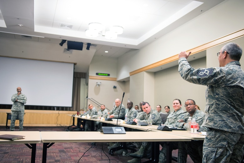 U.S. Air Force Chief Master Sgt. of the Air Force Kaleth O. Wright greets a Chief Master Sgt. attending an Air Force Element Senior Enlisted Leader Conference at the Pentagon, April 4, 2018.