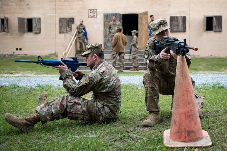 Airman 1st Class Loren Steed, right, and Airman Robert Ward, 824th Base Defense Squadron fire team members, set up perimeter defense during dismounted training operations, March 26, 2018, at Moody Air Force Base, Ga. The operations conducted were a part of the 820th Base Defense Group's (BDG) Initial Qualification Training, which is given to new Airmen coming into the BDG as an opportunity to learn a baseline of basic combat skills that will be needed to successfully operate as a cohesive unit while in a deployed environment. (U.S. Air Force photo by Airman 1st Class Erick Requadt)