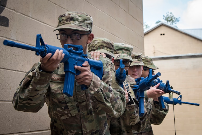 Airmen from the 820th Base Defense Group (BDG), prepare to advance their position during dismounted operations training, March 27, 2018, at Moody Air Force Base, Ga.  The dismounted ops training is part of an Initial Qualification Training, which gives new Airmen coming into the BDG an opportunity to learn a baseline of basic combat skills that will be needed to successfully operate within a cohesive unit while in a deployed environment. (U.S. Air Force photo by Airman Eugene Oliver)