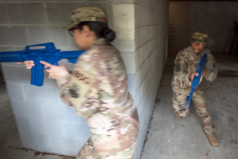 Airman 1st Class Kierra Carter, 824th Base Defense Squadron fireteam member, right, prepares to round a corner during dismounted operations training, March 27, 2018, at Moody Air Force Base, Ga.  The dismounted ops training is part of an Initial Qualification Training, which gives new Airmen coming into the 820th Base Defense Group an opportunity to learn a baseline of basic combat skills that will be needed to successfully operate within a cohesive unit while in a deployed environment. (U.S. Air Force photo by Airman Eugene Oliver)