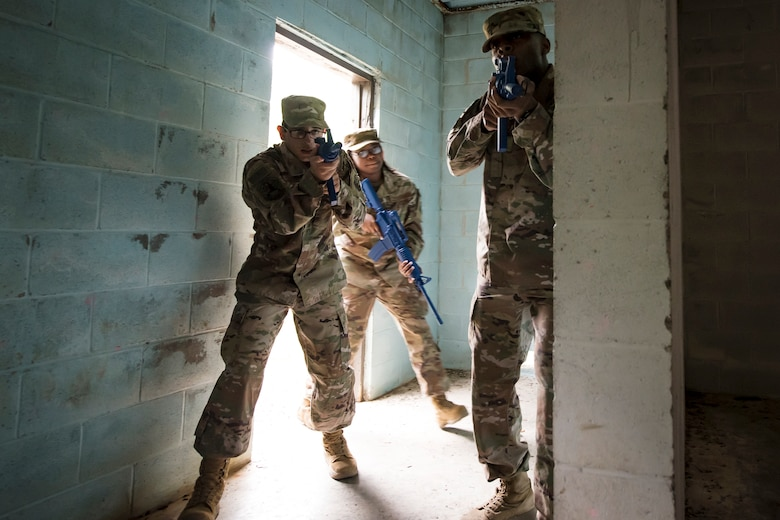 Airmen from the 820th Base Defense Group (BDG) enter a building during dismounted operations training, March 27th, 2018, at Moody Air Force Base, Ga. The dismounted ops training is part of an Initial Qualification Training, which gives new Airmen coming into the BDG an opportunity to learn a baseline of basic combat skills that will be needed to successfully operate within a cohesive unit while in a deployed environment. (U.S. Air Force photo by Airman Eugene Oliver)