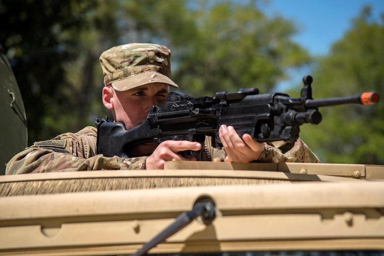 Airman 1st Class Alexander Moore, 824th Base Defense Squadron fireteam member, aims down the sight of a simulated weapon from the turret position of a Humvee during vehicle operations training, March 28, 2018, at Moody Air Force Base, Ga. The vehicle ops training is part of Initial Qualification Training, which gives new Airmen coming into the 820th Base Defense Group an opportunity to learn a baseline of basic combat skills that will be needed to successfully operate within a cohesive unit while in a deployed environment. (U.S. Air Force photo by Airman Eugene Oliver)