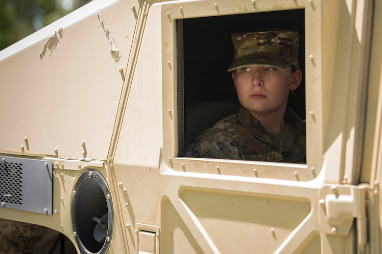 Airman 1st Class Emily Anderson, 822th Base Defense Squadron fireteam member, looks out the window frame of a Humvee during vehicle operations training, March 28, 2018, at Moody air Force Base, Ga The vehicle ops training is part of Initial Qualification Training, which gives new Airmen coming into the 820th Base Defense Group an opportunity to learn a baseline of basic combat skills that will be needed to successfully operate within a cohesive unit while in a deployed environment. (U.S. Air Force photo by Airman Eugene Oliver)