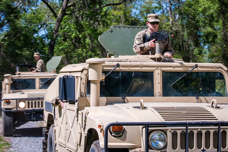 Airmen from 820th Base Defense Group (BDG), ride in a Humvee during vehicle operations training, March 28, 2018, at Moody Air Force Base, Ga. The vehicle ops training is part of Initial Qualification Training, which gives new Airmen coming into the BDG an opportunity to learn a baseline of basic combat skills that will be needed to successfully operate within a cohesive unit while in a deployed environment. (U.S. Air Force photo by Airman Eugene Oliver)