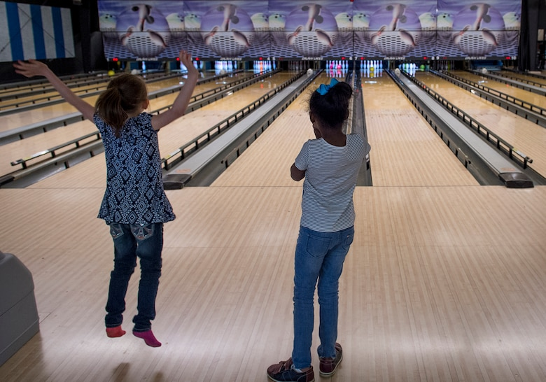 Students from the Altus Air Force Base Youth Center watch to see how many pins they knock down while bowling at the Galaxy Grill and Lanes, April 5, 2018, on Altus AFB, Okla.
