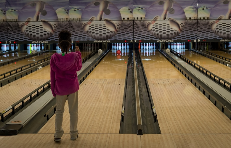 A student from the Altus Air Force Base Youth Center, crosses her fingers while bowling at the Galaxy Grill and Lanes, April 5, 2018, on Altus AFB, Okla.