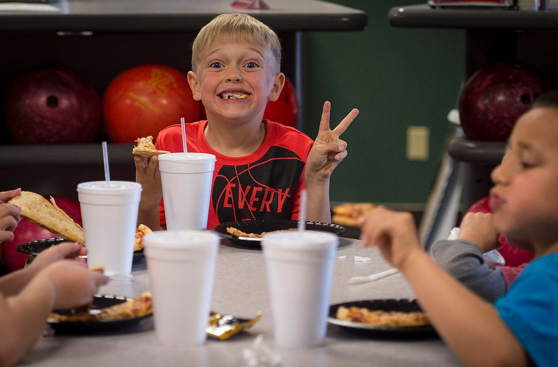 A student from the Altus Air Force Base Youth Center eats pizza at the Galaxy Grill and Lanes, April 5, 2018, on Altus AFB, Okla.