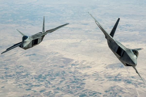 Air Force F-22 Raptors assigned to the 95th Expeditionary Fighter Squadron fly above Syria, March 25, 2018, in support of Operation Inherent Resolve. Air National Guard photo by Staff Sgt. Colton Elliott