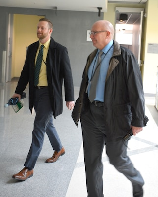 Chris Boeding walks with DLA Energy Deputy Commander Guy Beougher
