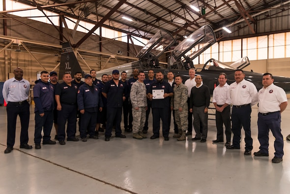 "Abraham Herrera, 47th Maintenance Directorate aircraft maintenance mechanic, was chosen by wing leadership to be the ""XLer"" of the week, for the week of Apr. 2, 2018, at Laughlin Air Force Base, Texas. The ""XLer"" award, presented by Col. Charlie Velino, 47th Flying Training Wing commander, is given to those who consistently make outstanding contributions to their unit and the Laughlin mission. (U.S. Air Force photo by Airman 1st Class Daniel Hambor)"
