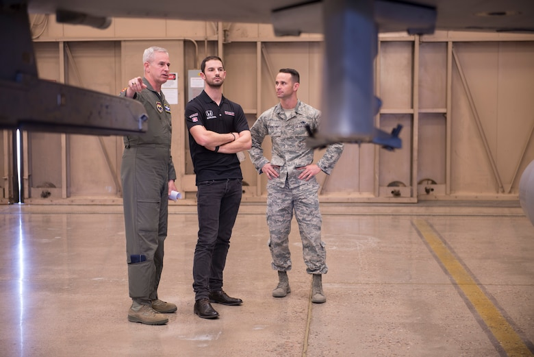 Col. Michael Richardson, 56th Fighter Wing vice commander; Alexander Rossi, Andretti Autosport racecar driver; and Master Sgt. Justin Kruithof, 56th Equipment Maintenance Squadron fabrication flight superintendent, talk about the F-16 Fighting Falcon and its capabilities at Luke Air Force Base, Ariz., April 5, 2018. Rossi, an Indycar racer, greeted Airmen at a variety of locations as he toured the base. (U.S. Air Force photo by Senior Airman Ridge Shan)