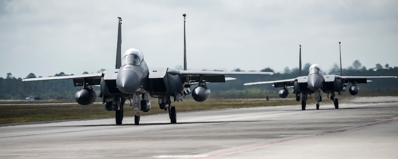 Image of two F-15E Strike Eagles taxying down the runway at Tyndall Air Force Base, Florida, April 3, 2018. Combat Archer and Hammer tests both air-to-air and air-to-ground maneuvers. 