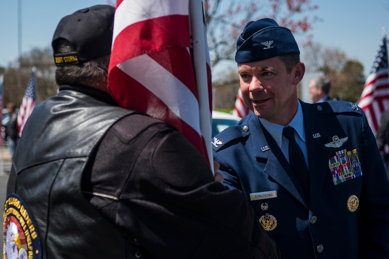 Col. Brian Armstrong, 4th Fighter Wing vice commander, thanks a member of the Patriot Guard Riders of North Carolina, April 5, 2018, in Raleigh, North Carolina.