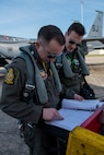 1st Lts. Jacob Del Ponte (left), 336th Fighter Squadron pilot, and Shane O'Connell, 335th Fighter Squadron weapon systems officer, check the maintenance log of an F-15E Strike Eagle prior to take off for Razor Talon, April 6, 2018, at Seymour Johnson Air Force Base, North Carolina.