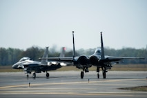 Two F-15E Strike Eagles from the 335th Fighter Squadron taxi down the runway to participate in Razor Talon, April 6, 2018, at Seymour Johnson Air Force Base, North Carolina.
