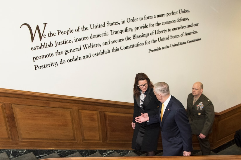 Defense Secretary James N. Mattis and Slovenian Defense Minister Andreja Katič walk up steps in the Pentagon.