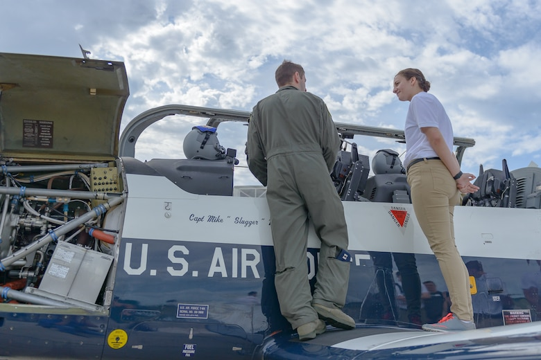 U.S. Air Force Capt. Brett Boudreaux, 14th Flying Training Wing pilot, Columbus Air Force Base, Columbus, Mississippi, talks to Cassandra Richmond, Auburn University Air Force ROTC cadet, during Pathways to Blue April 6, 2018, on Keesler Air Force Base, Mississippi. Cadets received an orientation flight along with hands-on briefings on technical and flying operations in support of the Air Force's Diversity Strategic Roadmap program. Keesler was home to 280 cadets from 15 universities April 6-7 as part of Pathways to Blue, a diversity outreach event hosted by the 2nd Air Force.  (U.S. Air Force photo by Andre' Askew)