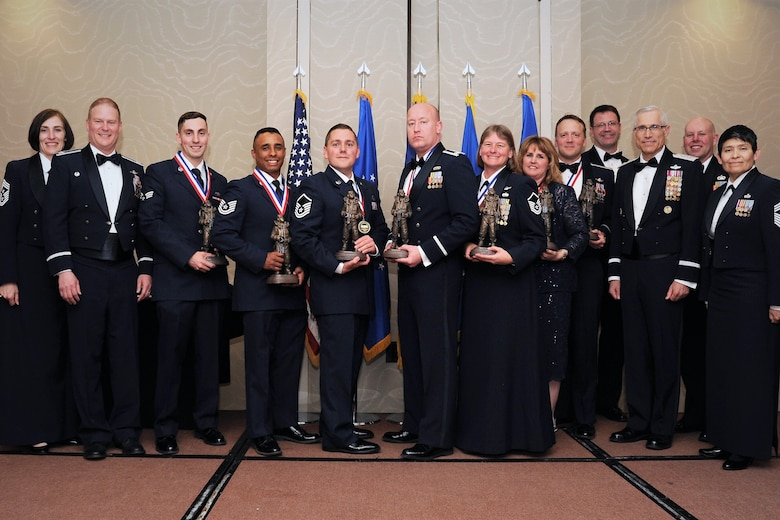 The 302nd Airlift Wing 2017 annual award winners pose for a photo during a ceremony in Colorado Springs, Colorado, April 7, 2018. The annual awards program recognizes outstanding achievements in the areas of leadership, job performance, significant self-improvement and contributions to both on and off-base communities. (U.S. Air Force photo by Staff Sgt. Frank Casciotta)