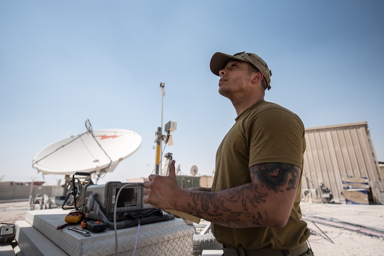 U.S. Air Force Staff Sgt. Joshua Foster, a radio frequency transmissions technician with the 379th Operations Support Squadron, uses a spectrum analyzer to perform diagnostics on a satellite at Al Udeid Air Base, Qatar, Mar. 30, 2018. Silent Sentry protects critical satellite communication links by employing multiple weapons systems for electronic warfare. (U.S. Air National Guard photo by Master Sgt. Phil Speck)
