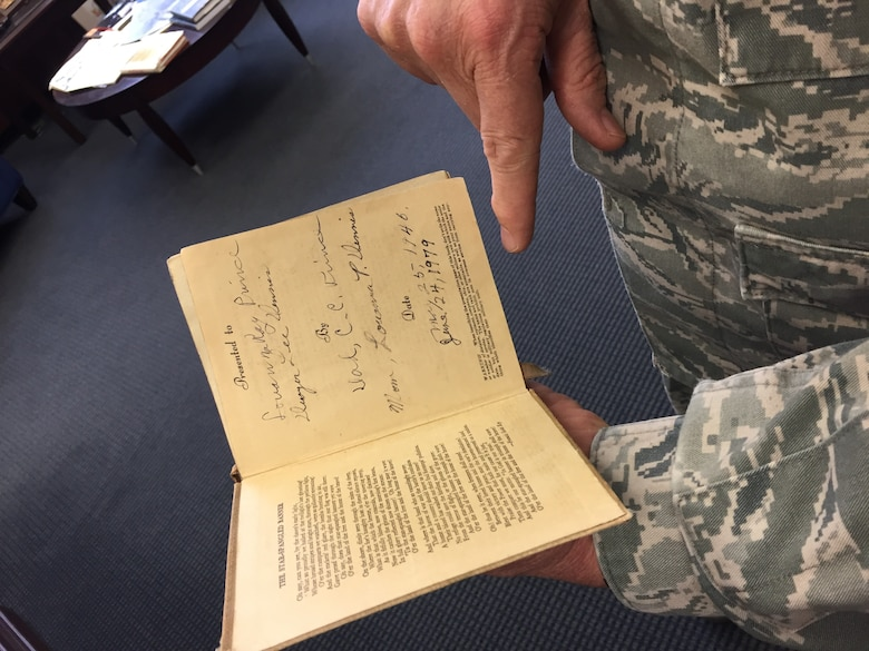 Maj. Gen. Dwyer Dennis, program executive officer for the Command, Control, Communications, Intelligence and Networks Directorate at Hanscom Air Force Base, Mass., holds a daily prayer devotionals in his office, April 6, 2018. The devotional belonged to his maternal grandfather, who was a U.S. Army Chaplain during World War II, serving in both theaters. Dennis is set to retire April 13 after serving 35 years as a U.S. Air Force officer. (U.S. Air Force Photo by Benjamin Newell)
