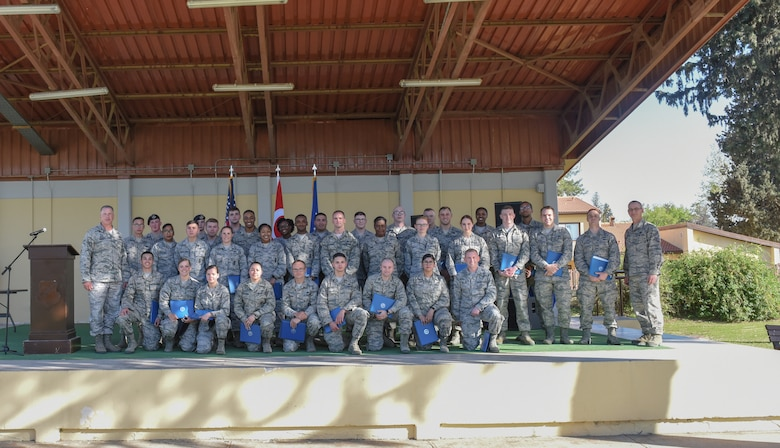 Airmen pose for photo after receiving medals