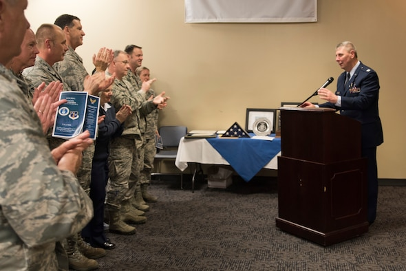 Newly retired Col. Thomas Smith, former Joint Force Headquarters Command Chaplain, addresses members of the 188th Wing during his retirement ceremony at Fort Smith, AR., Apr. 07, 2018. (U.S. Air National Guard photo by Tech. Sgt. Daniel Condit)