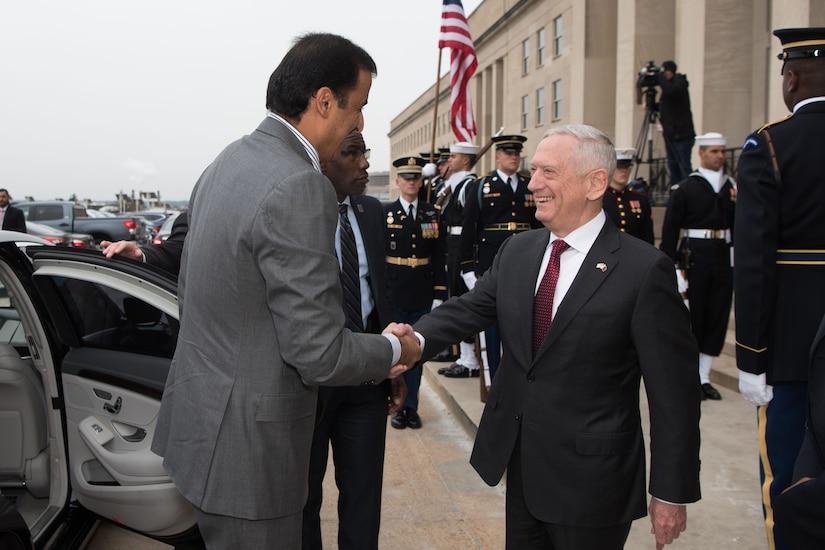 Defense Secretary James N. Mattis shakes hands with Sheikh Tamim bin Hamad Al Thani, emir of Qatar.
