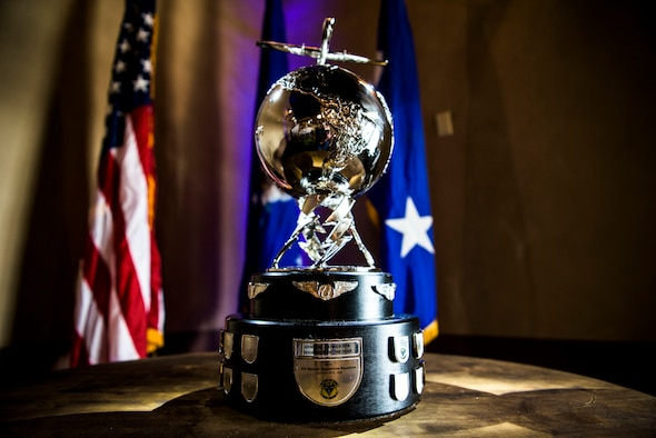 The 2016 General Atomics RPA Squadron of the Year trophy sits in front of flags during a banquet April 6, 2018, at Traci's Greenhouse in Clovis, N.M. The banquet was held for the 3rd Special Operations Squadron at Cannon AFB, N.M., who was being awarded the trophy. (U.S. Air Force photo by Senior Airman Luke Kitterman/Released)