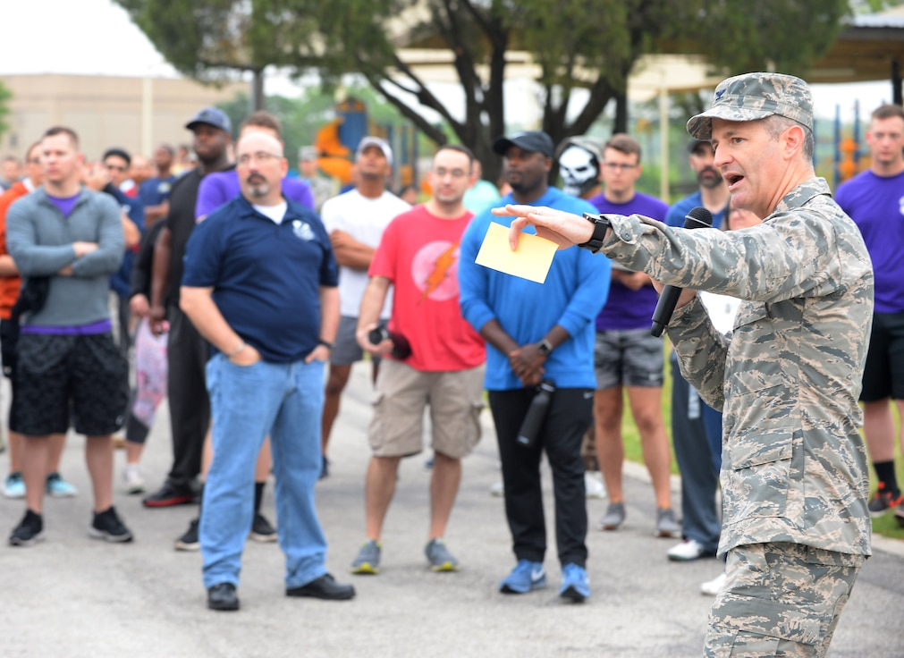 "Col. Bradley Pyburn, 67th Cyberspace Wing commander, welcomes wing members to the annual safety day event at Joint Base San Antonio-Lackland, Texas, April 6, 2018. The sports and recreation themed event included several sports competitions and a ""Gunslinger"" warrior challenge to provide the participants more situational awareness and risk management techniques to consider during these activities. (U.S. Air Force photo by Tech. Sgt. R.J. Biermann)"