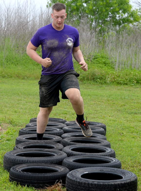 "A 68th Network Warfare Squadron ""Purple Dragons"" team member, completes a tire run during the 67th Cyberspace Wing annual safety day ""Gunslinger"" warrior challenge at Joint Base San Antonio-Lackland, Texas, April 6, 2018. The challenge pitted several teams against one another in seven timed events, where the ""Purple Dragons"" captured first place. (U.S. Air Force photo by Tech. Sgt. R.J. Biermann)"