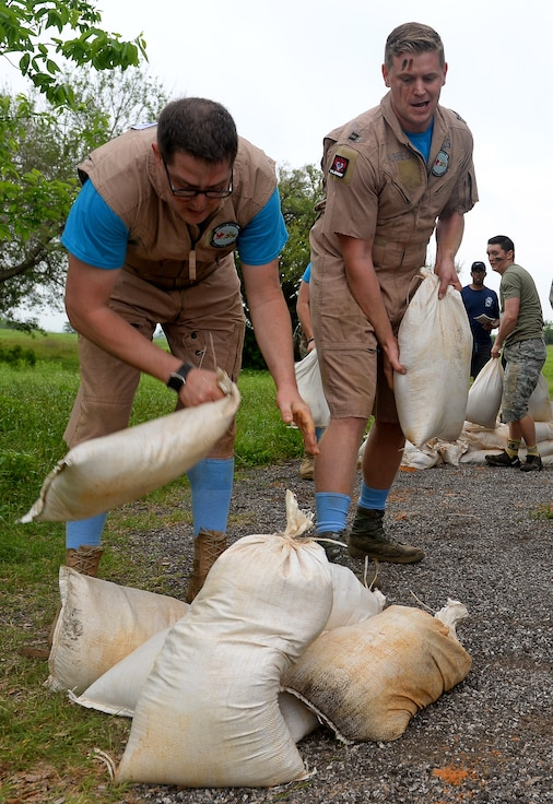 """The 91st Cyberspace Operations Squadron """"Demon Chasers"""" team builds a sandbag wall during the 67th Cyberspace Wing annual safety day """"Gunslinger"""" warrior challenge at Joint Base San Antonio-Lackland, Texas, April 6, 2018. The challenge pitted several teams against one another in seven timed events, where the 68th Network Warfare Squadron """"Purple Dragons"""" captured first place. (U.S. Air Force photo by Tech. Sgt. R.J. Biermann)"""