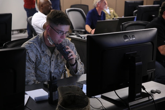 Cpl. Ryan Griffing, rifleman, 1st Battalion, 4th Marine Regiment, stationed out of Marine Corps Base Camp Pendleton, Calif., calls in a 9-line during Command Post Exercise 2 at the Battle Simulation Center aboard the Marine Corps Air Ground Combat Center, Twentynine Palms, Calif., March 29, 2018. CPX-2 is a two-part training event that focuses on training battalion staff and is a part of TALONEX 2-18, a pre-deployment training event that coincides with Weapons and Tactics Instructors Course. (U.S. Marine Corps photo by Lance Cpl. Isaac Cantrell)