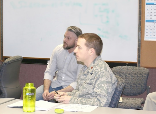 Eddie Mickle, left, work planner for the Aeropropulsion Combined Test Force at Arnold Air Force Base, in a scheduling meeting March 26. Maj. Michael Knauf, AEDC Aeropropulsion Operations Officer, looks on at right. Mickle has been recognized by his supervisors for his efforts supporting the integrated schedule, which serves as a valuable tool to assess progress and issues. (U.S. Air Force photo/Deidre Ortiz)
