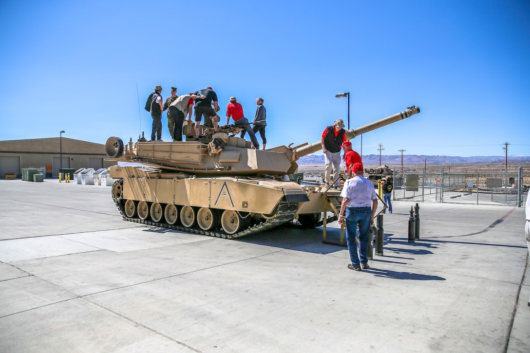 Veterans with the Desert Cities Mitchell Paige Medal of Honor Chapter, 1st Marine Division Association, tour the tanks of today's Marine Corps during an Alumni Day hosted by 7th Marine Regiment aboard the Marine Corps Air Ground Combat Center, Twentynine Palms, Calif., March 28, 2018. The day was hosted to cultivate and strengthen relationships between active-duty Marines and those who served. (U.S. Marine Corps photo by Lance Cpl. Rachel K. Porter)