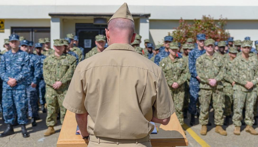 U.S. Navy Cmdr. Timothy Knapp, Center for Naval Aviation Technical Training Unit Keesler commanding officer, delivers opening remarks during the CNATTU Keesler's Chief Petty Officer Birthday Ceremony at Keesler Air Force Base, Mississippi, April 5, 2018. The U.S. Navy's Chief Petty Officers are celebrating 125 years of heritage and the naval tradition of 