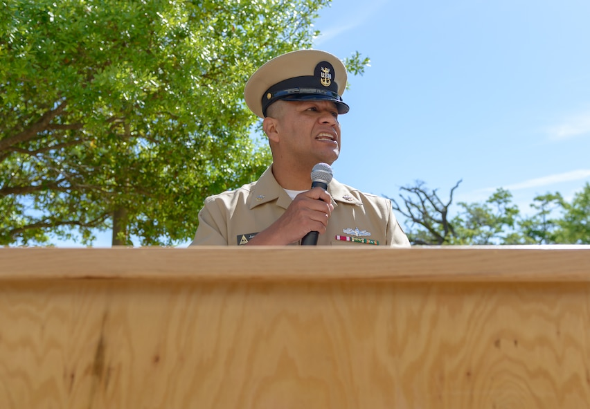 """U.S. Navy Master Chief Petty Officer James Contreras, Center for Naval Aviation Technical Training Unit Keesler command master chief, delivers opening remarks during the CNATTU Keesler's Chief Petty Officer Birthday Ceremony at Keesler Air Force Base, Mississippi, April 5, 2018. The U.S. Navy's Chief Petty Officers are celebrating 125 years of heritage and the naval tradition of Unity, Service and Navigation, which is part of their rate emblem, is symbolized by a fouled anchor with the letters """"USN"""" centered on the anchor. (U.S. Air Force photo by André Askew)"""