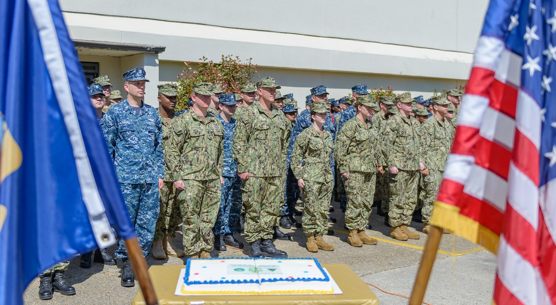 """Center for Naval Aviation Technical Training Unit Keesler personnel stand in formation as opening remarks were given during the CNATTU Keesler's Chief Petty Officer Birthday Ceremony at Keesler Air Force Base, Mississippi, April 5, 2018. The U.S. Navy's Chief Petty Officers are celebrating 125 years of heritage and the naval tradition of Unity, Service and Navigation, which is part of their rate emblem, is symbolized by a fouled anchor with the letters """"USN"""" centered on the anchor. (U.S. Air Force photo by André Askew)"""