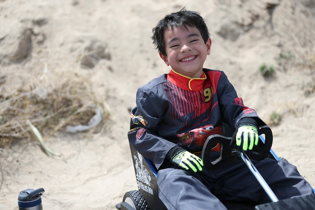 Nathaniel Nieves, 5, son of Gunnery Sgt. Joel A. Nieves, data chief, Tactical Training Exercise Control Group, prepares to participate in the soapbox derby during the 18th Annual Car Show and Street Fair, which was hosted by the Twentynine Palms Chamber of Commerce in Twentynine Palms, Calif., March 31, 2018. The annual event is used to bring the community of Twentynine Palms and the Marine Corps Air Ground Combat Center, located in Twentynine Palms, together as well as support local businesses. (U.S. Marine Corps photo by Lance Cpl. Rachel K. Porter)