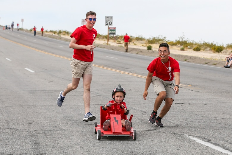 Volunteers with the Armed Services YMCA assist a participant of the soapbox derby down the course during the 18th Annual Car Show and Street Fair, which was hosted by the Twentynine Palms Chamber of Commerce in Twentynine Palms, Calif., March 31, 2018. The annual event is used to bring the community of Twentynine Palms and the Marine Corps Air Ground Combat Center, located in Twentynine Palms, together as well as support local businesses. (U.S. Marine Corps photo by Lance Cpl. Rachel K. Porter)