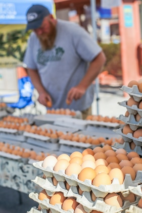 Roger Thomas, co-owner, Thomas Farms, places eggs from his farm into dozen batches in preparation to sell during the 18th Annual Car Show and Street Fair, which was hosted by the Twentynine Palms Chamber of Commerce in Twentynine Palms, Calif., March 31, 2018. The annual event is used to bring the community of Twentynine Palms and the Marine Corps Air Ground Combat Center, located in Twentynine Palms, together as well as support local businesses. (U.S. Marine Corps photo by Lance Cpl. Rachel K. Porter)