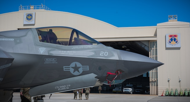 An F-35B Lightning II sits in front of a hanger on MacDill Air Force Base, Fla., April 4, 2018. The F-35B Lightning II visited MacDill Air Force Base to display capabilities to U.S. Central Command. (U.S. Marine Corps photo by Sgt. Warren Smith.)