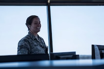 U.S. Air Force Staff Sgt. Elizabeth Gordon, 20th Operations Support Squadron watch supervisor, laughs while speaking to her Airmen at Shaw Air Force Base, S.C., April 5, 2018.