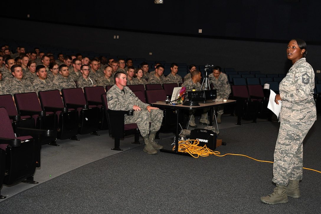U.S. Air Force Senior Master Sgt. Tiffany Patterson, 81st Force Support Squadron career assistance advisor, speaks to Airmen during the Airmen Building Airmen Symposium at the Welch Theater at Keesler Air Force Base, Mississippi, April 6, 2018. The symposium also included a question and answer panel and a video. The symposium was held to empower Airmen and help them understand the impact they have on the future of the Air Force. (U.S. Air Force photo by Airman 1st Class Suzie Plotnikov)