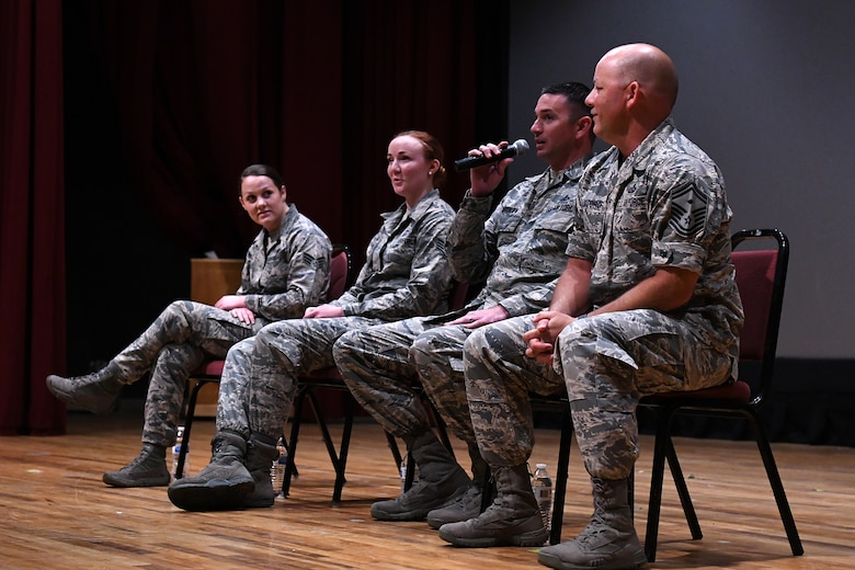 U.S. Air Force Master Sgt. Jason Burdett, 81st Security Forces Squadron first sergeant, answers a question during the question and answer portion of the Airmen Building Airmen Symposium at the Welch Theater at Keesler Air Force Base, Mississippi, April 6, 2018. The symposium also included a guest speaker and a video. The symposium was held to empower Airmen and help them understand the impact they have on the future of the Air Force. (U.S. Air Force photo by Airman 1st Class Suzie Plotnikov)