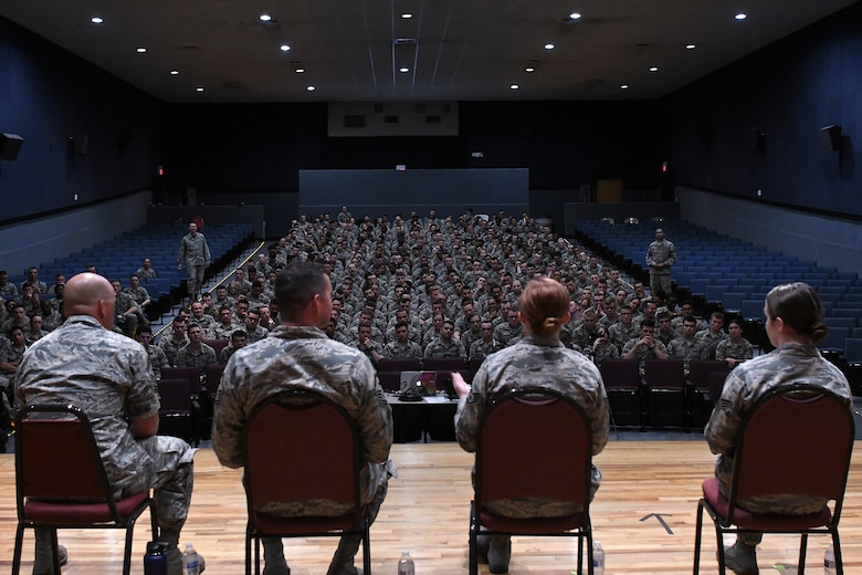 A discussion panel answers questions during the Airmen Building Airmen Symposium at the Welch Theater at Keesler Air Force Base, Mississippi, April 6, 2018. The symposium also included a guest speaker and a video. The symposium was held to empower Airmen and help them understand the impact they have on the future of the Air Force. (U.S. Air Force photo by Airman 1st Class Suzie Plotnikov)