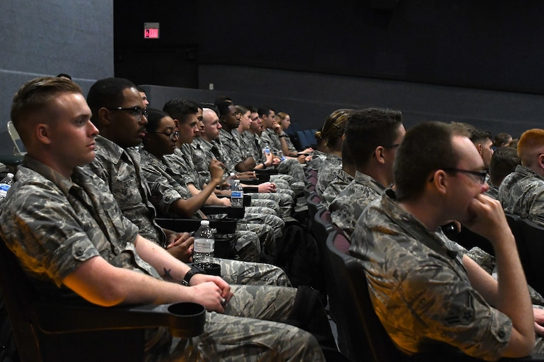 Keesler Airmen attend the Airmen Building Airmen Symposium at the Welch Theater at Keesler Air Force Base, Mississippi, April 6, 2018. The symposium included a guest speaker, a question and answer panel and a video. The symposium was held to empower Airmen and help them understand the impact they have on the future of the Air Force. (U.S. Air Force photo by Airman 1st Class Suzie Plotnikov)