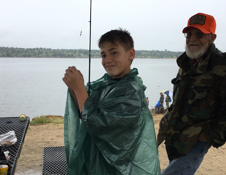 A young boy prepares his fishing rod before casting his line at Kids Fishing Day on April 7, 2018 at Eastman Lake. Experienced anglers were on-hand to teach participants basic fishing skills such as tying hooks, proper casting techniques and patience – an important skill every angler needs.
